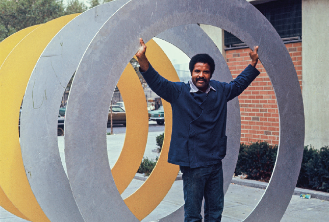 Melvin Edwards with his sculpture, Double Circles, 1970. Photo: Courtesy the artist + Alexander Gray Associates, New York and Stephen Friedman Gallery, London..PNG