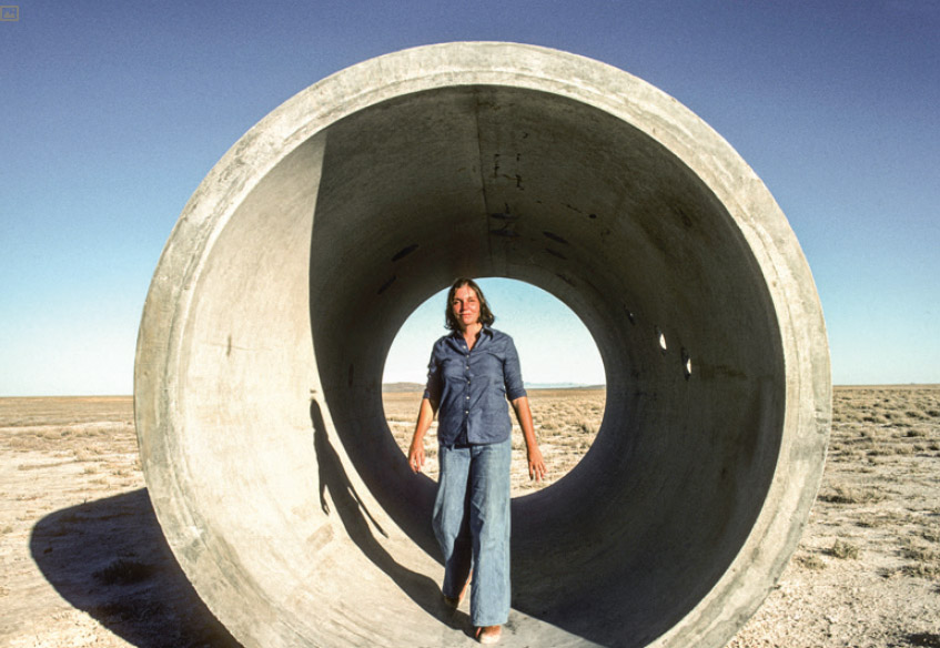 Nancy Holt, photographed at Sun Tunnels, Utah, 1970s. Photo: © Holt + Smithson Foundation and Dia Art Foundation, Licensed by VAGA at Artists Rights Society (ARS), New York  and DACS, London..PNG