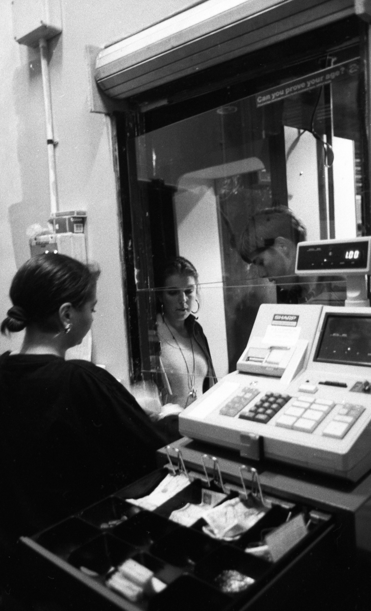 Peter J Walsh - Rave One - Paying for entry at The Hacienda - reception area.jpg